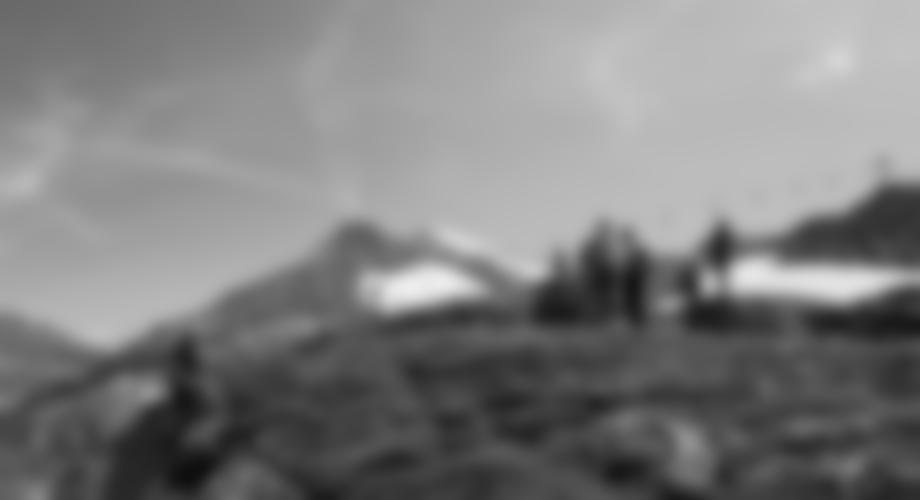 Das Ende des Klettersteiges bei einem großen Steinmann.